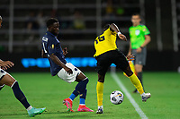ORLANDO, FL - JULY 20: Blair Turgott #15 of Jamaica kicks the ball during a game between Costa Rica and Jamaica at Exploria Stadium on July 20, 2021 in Orlando, Florida.