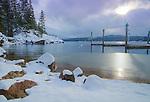 Idaho, North, Kootenai County, Coeur d'Alene. Snow covered rocks on the shore of Lake Coeur d'Alene at Tubbs Hill Nature Park.