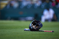 Fort Myers Miracle helmet and bat in the grass in between innings during a game against the Bradenton Marauders on April 9, 2016 at McKechnie Field in Bradenton, Florida.  Fort Myers defeated Bradenton 5-1.  (Mike Janes/Four Seam Images)