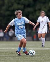 University of North Carolina forward Alexa Newfield (88) brings the ball forward.   University of North Carolina (blue) defeated Boston College (white), 1-0, at Newton Campus Field, on October 13, 2013.
