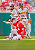 21 June 2015: Washington Nationals catcher Jose Lobaton looks back to first during game action against the Pittsburgh Pirates at Nationals Park in Washington, DC. The Nationals defeated the Pirates 9-2 to sweep their 3-game weekend series, and improve their record to 37-33. Mandatory Credit: Ed Wolfstein Photo *** RAW (NEF) Image File Available ***