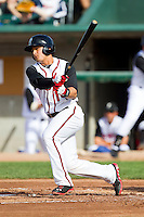 Christian Lopes (14) of the Lansing Lugnuts follows through on his swing against the Beloit Snappers at Cooley Law School Stadium on May 5, 2013 in Lansing, Michigan.  The Lugnuts defeated the Snappers 5-4.  (Brian Westerholt/Four Seam Images)