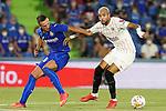 Getafe CF's Nemanja Maksimovic (l) and Sevilla FC's Youssef En-Nesyri during La Liga match. August 23,2021. (ALTERPHOTOS/Acero)