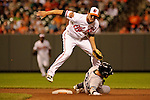 Baltimore, MD- May 15:.Nick Swisher of the Yankees is tagged out by Ryan Adams during the New York Yankees v Baltimore Orioles  at Oriole Park at Camden Yards in Baltimore, MD on 05/15/12. (Ryan Lasek/ Eclipse Sportswire)