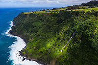 An aerial view of a waterfall and Waipi'o Valley, Big Island of Hawai'i.