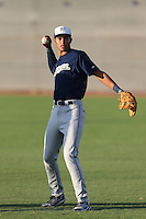 Jake Gatewood #18 of the AZL Brewers warms up before a game against the AZL Reds at the Cincinnati Reds Baseball Complex on July 5, 2014 in Goodyear, Arizona. (Larry Goren/Four Seam Images)