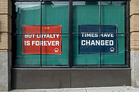 """Signs in the windows of Boston Beer Works near Fenway Park read """"See you next season,"""" and """"Times have changed,"""" and """"But loyalty is forever,"""" while the restaurant and bar is temporarily closed during the ongoing Coronavirus (COVID-19) global pandemic in Boston, Massachusetts, on Wed., Jan. 6, 2021. All locations of Boston Beer Works closed on March 16, 2020. An announcement on the company's website reads, in part that the bars will remain closed """"until the Governor determines it is safe for our industry to resume operations. ... We greatly appreciate all the support that our fans have provided us and our staff. These are challenging times, but we will rally together and weather this storm like we have so many others in the past."""""""