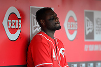 Cincinnati Reds second baseman Brandon Phillips #4 in the dugout during a game against the Miami Marlins at Great American Ball Park on April 20, 2013 in Cincinnati, Ohio.  Cincinnati defeated Miami 3-2 in 13 innings.  (Mike Janes/Four Seam Images)