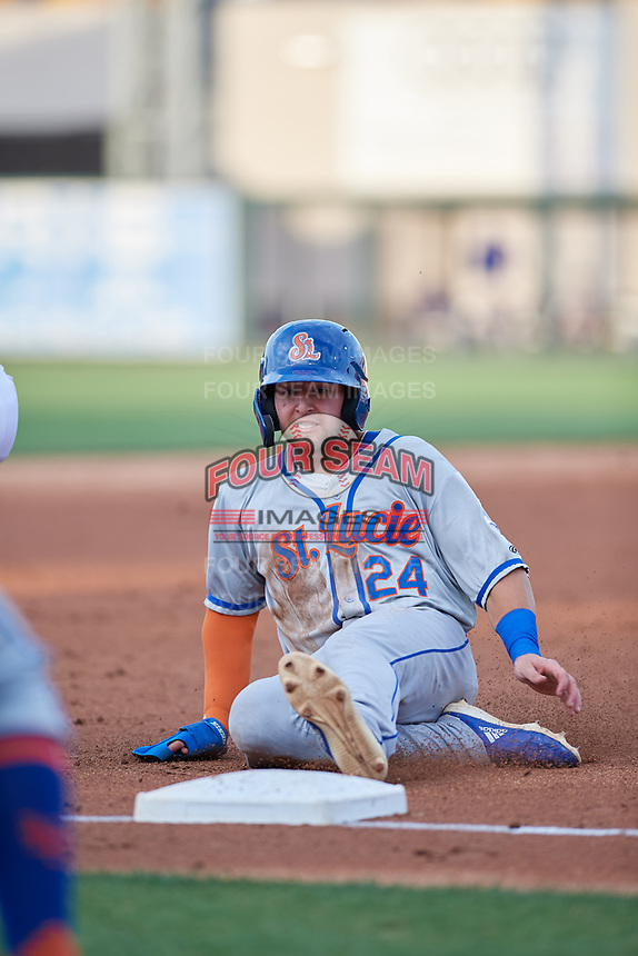 St. Lucie Mets Blake Tiberi (24) slides safely into third base during a Florida State League game against the Lakeland Flying Tigers on April 24, 2019 at Publix Field at Joker Marchant Stadium in Lakeland, Florida.  Lakeland defeated St. Lucie 10-4.  (Mike Janes/Four Seam Images)
