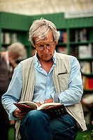 Tuesday 31 May 2016<br /> Pictured: A man reads a book in the festival book store<br /> Re: The 2016 Hay festival take place at Hay on Wye, Powys, Wales