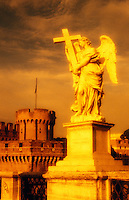Italy, Rome. Ponte San Angelo. Statue of Angel holding a cross.
