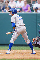 Angelo Castellanos (13) of the Burlington Royals blows a bubble while at bat against the Pulaski Mariners at Calfee Park on June 20, 2014 in Pulaski, Virginia.  The Mariners defeated the Royals 6-4. (Brian Westerholt/Four Seam Images)