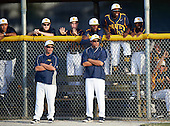Boca Ciega Pirates coaches and players, including Desmond Mack (14), Chris Riley (13) and Anquante Allen (31), watch the action from the dugout during a game against the Lakeland Spartans at Boca Ciega High School on March 2, 2016 in St. Petersburg, Florida.  (Copyright Mike Janes Photography)