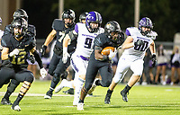 Joshua Ficklin (1) of  Bentonville runs  the ball against with Justin Logue (9) of Fayetteville in pursuit at Tigers Stadium, Bentonville, Arkansas on Friday, October 16, 2020 / Special to NWA Democrat-Gazette/ David Beach