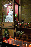 Cuba, Havana.  Church of La Merced, Mary and Jesus, with Votive Candles.