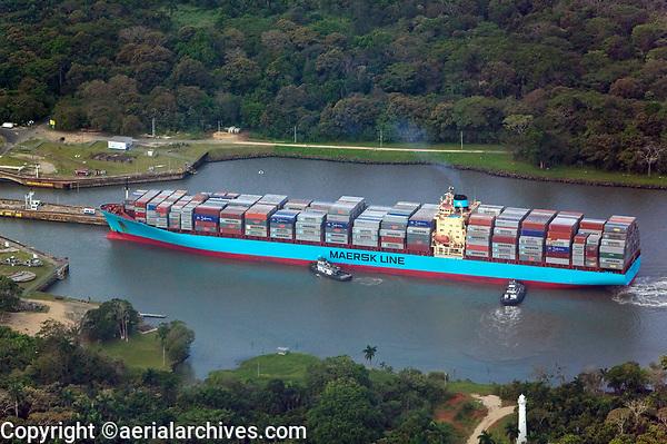 aerial photograph of two tug boats positioning a loaded Maersk containership for entry into the Miraflores Locks, Panama Canal, Panama | fotografía aérea de las esclusas de Miraflores, Canal de Panamá