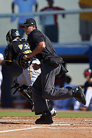 Home plate umpire Justin Juska hustles to get into position to make a call during the Appalachian League game between the Bristol Pirates and the Danville Braves at American Legion Post 325 Field on July 1, 2018 in Danville, Virginia. The Braves defeated the Pirates 3-2 in 10 innings. (Brian Westerholt/Four Seam Images)