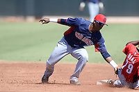 Cleveland Indians shortstop Claudio Bautista (1) attempts to tag Carlton Daal (79) sliding in safely during an instructional league game against the Cincinnati Reds on September 28, 2013 at Goodyear Training Complex in Goodyear, Arizona.  (Mike Janes/Four Seam Images)