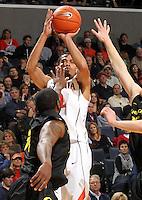 Dec. 17, 2010; Charlottesville, VA, USA; Virginia Cavaliers guard Mustapha Farrakhan (2) shoots over Oregon Ducks forward Joevan Catron (34) during the game at the John Paul Jones Arena. Virginia won 63-48. Mandatory Credit: Andrew Shurtleff-