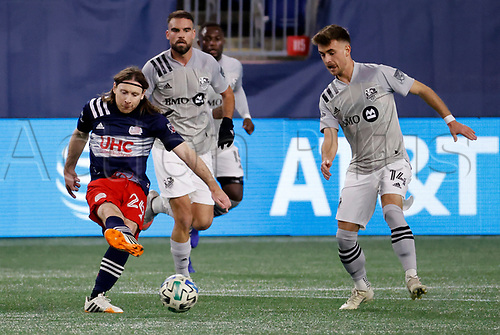 20th November 2020; Foxborough, MA, USA;  New England Revolution midfielder Tommy McNamara plays the ball away from Montreal Impact midfielder Amarettos Sejdic during the MLS Cup Play-In game between the New England Revolution and the Montreal Impact