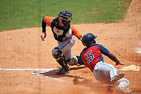Austin Biggar (32) of Parkview High School in Canton, Georgia playing for the Baltimore Orioles scout team tags Grant Bodison (15) sliding home during the East Coast Pro Showcase on July 30, 2015 at George M. Steinbrenner Field in Tampa, Florida.  (Mike Janes/Four Seam Images)