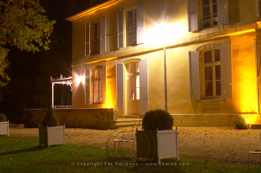 Chateau Belingard and garden at night lit up with flood lights. Chateau Belingard Bergerac Dordogne France