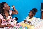 22 month old toddler girl with mother interaction tea party