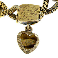 BNPS.co.uk (01202 558833)<br /> Pic: Fellows/BNPS<br /> <br /> Pictured: 'From Victoria R, July 16th 1850, Victoria' engraved on the locket.<br /> <br /> A poignant bracelet that belonged to Queen Victoria and still contains a lock of her daughter's hair has sold for almost £4000.<br /> <br /> The extraordinary piece of jewellery has five lockets attached to it and each would have held strands of hair of her children at the time.<br /> <br /> She had the names of Princesses Victoria, Alice, Louise and Helena and Prince Alfred engraved on the bracelet.