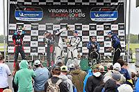 #23 Fast MD Racing Audi RS3 LMS TCR DSG, TCR: Nick Galante, James Vance, Nick Galante, #21 Byan Herta Autosport W Curb-Agajanian Hyundai Veloster N TCR, TCR: Mason Filippi, Harry Gottsacker, #54 JDC-Miller MotorSports Audi RS3 LMS TCR DSG, TCR: Michael Johnson, Stephen Simpson celebrate the win on the podium with champagne