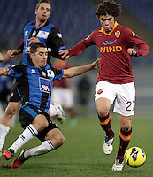 Calcio, ottavi di finale di Coppa Italia: Roma vs Atalanta. Roma, stadio Olimpico, 11 dicembre 2012..AS Roma defender Dodo', of Brazil, is challenged by Atalanta midfielder Carlos Carmona, of Chile, left, during their Italy Cup last-16 tie football match between AS Roma and Atalanta at Rome's Olympic stadium, 11 december 2012. .UPDATE IMAGES PRESS/Riccardo De Luca
