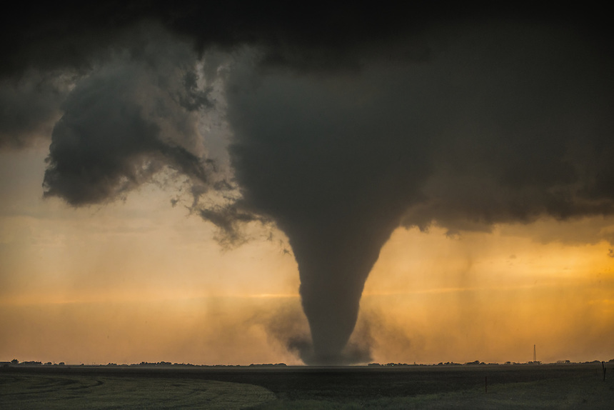 A strong tornado looms on the horizon south of Rozel Kansas on May 18th, 2013. This storm destroyed crops and damaged several farmsteads.