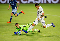 CARSON, CA - OCTOBER 18: Cristian Pavon #10 of the Los Angeles Galaxy attempts to move past Evan Bush #30 of the Vancouver Whitecaps during a game between Vancouver Whitecaps and Los Angeles Galaxy at Dignity Heath Sports Park on October 18, 2020 in Carson, California.
