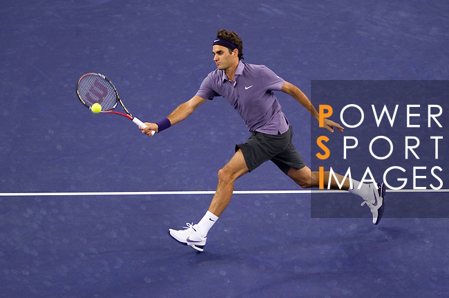 SHANGHAI, CHINA - OCTOBER 13:  Roger Federer of Switzerland returns a ball to John Isner of USA during day three of the 2010 Shanghai Rolex Masters at the Shanghai Qi Zhong Tennis Center on October 13, 2010 in Shanghai, China.  (Photo by Victor Fraile/The Power of Sport Images) *** Local Caption *** Roger Federer