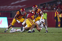 LOS ANGELES, CA - SEPTEMBER 11: Benjamin Yurosek #84 of the Stanford Cardinal is brought down by Isaiah Pola-Mao #21 of the USC Trojans after a pass reception during a game between University of Southern California and Stanford Football at Los Angeles Memorial Coliseum on September 11, 2021 in Los Angeles, California.