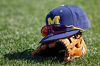 Michigan Wolverines hat & glove Game 1 of the NCAA College World Series Finals on June 24, 2019 at TD Ameritrade Park in Omaha, Nebraska. Michigan defeated Vanderbilt 7-4. (Andrew Woolley/Four Seam Images)