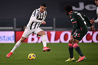 Cristiano Ronaldo of Juventus FC and Sebastiano Luperto of FC Crotone compete for the ball during the Serie A football match between Juventus FC and FC Crotone at Allianz stadium in Torino (Italy), February 22th, 2021. Photo Federico Tardito / Insidefoto