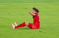 YOKOHAMA, JAPAN - AUGUST 6: Christine Sinclair #12 of Canada sits on the field after being fouled during a game between Canada and Sweden at International Stadium Yokohama on August 6, 2021 in Yokohama, Japan.