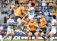 2nd October 2021, Cbus Super Stadium, Gold Coast, Queensland, Australia;  Reece Hodge and Santiago Carreras go for the ball. Australian Wallabies versus Argentina Pumas. Rugby Championship test match. Rugby Union. Gold Coast, Australia.