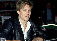 January 17, 1985 File Photo - Bryan Adams sign autographs for fans in a Montreal downtown record shop.