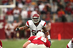 Rey Maualuga (#58) directs the defense from his middle linebacker position during a game between the University of Southern California Trojans and the Washington State Cougars at Martin Stadium in Pullman, Washington, on October 18, 2008.  The Trojans won the game 69-0 to help solidify their spot as one of the top ten teams in the country.