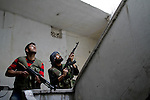Free Syria Army soldiers inspect a house in one of Aleppo's neighborhoods on Wednesday, October 10, 2012. ..© Javier Manzano..