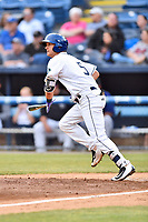 Asheville Tourists second baseman Matt McLaughin (5 ) runs to first base during a game against the Greensboro Grasshoppers at McCormick Field on May 11, 2018 in Asheville, North Carolina. The Tourists defeated the Grasshoppers 10-5. (Tony Farlow/Four Seam Images)