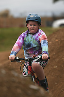 Hamilton Sperry, 7, of Kansas City rides, Monday, October 11, 2021 along the dirt jump ramps at the Mama Bear trail in Bentonville. He and his father got into mountain biking within the past year and like to visit Northwest Arkansas to ride the trails. Check out nwaonline.com/211012Daily/ for today's photo gallery. <br /> (NWA Democrat-Gazette/Charlie Kaijo)