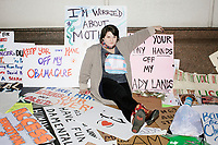 After the protest, people displayed protest signs they brought to the 2017 Women's March on Washington along a sidewalk north of the National Mall on Jan. 21, 2017, in Washington D.C.
