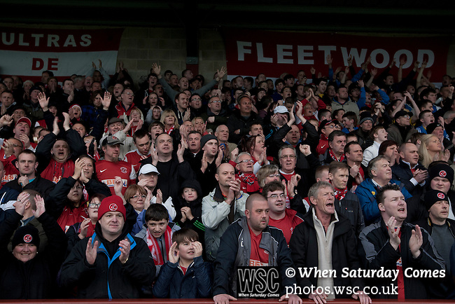 Fleetwood Town 1 Wrexham 1, 10/04/2012. Highbury Stadium, Football Conference Premier. Home supporters in the Memorial Stand cheering their team on to the pitch before Fleetwood Town host Wrexham in a Blue Square Conference Premier match at Highbury Stadium. The match, between the top two teams in the division ended in a 1-1 draw watched by a near-capacity crowd of 4996. A victory for the hosts would have seen the club promoted to the Football League for the first time. Photo by Colin McPherson.
