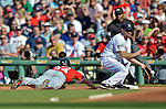 9 June 2012: Washington Nationals outfielder Bryce Harper dives back safely to first as Boston Red Sox Kevin Youkilis gets a throw from the mound during game action at Fenway Park in Boston, MA. The Nationals defeated the Red Sox 4-2 in the second game of their 3-game series. Mandatory Credit: Ed Wolfstein Photo