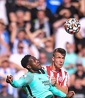 11th September 2021; Brentford Community Stadium, London, England;  Premier League football, Brentford versus Brighton Athletic; Kristoffer Ajer of Brentford competes for the ball with Danny Welbeck of Brighton