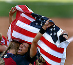 USA #2 Jessica Mendoza holds an American flag as she celebrates the teams Gold medal win over Australia 5-1 at the 2004 Summer Olympic Games in Athens,Greece on Monday, August 23rd, 2004.           DENVER POST PHOTO BY STEVE DYKES