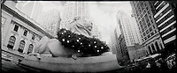Wreath draped lion in front of New York Public Library<br />
