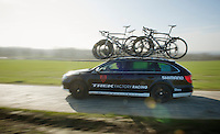 Trek Factory Racing teamcar with DS Dirk De Wolf rushing behind the peloton over the Oude Kwaremont cobbles<br /> <br /> 3 Days of West-Flanders <br /> stage 1: Brugge - Harelbeke 183km
